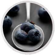 blueberries and a silver spoon on distressed wood No. 2 Round Beach Towel