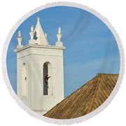 Church Bell Tower Behind Tiled Roofs In Tavira Round Beach Towel