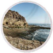 Cliff In The Ocean Round Beach Towel