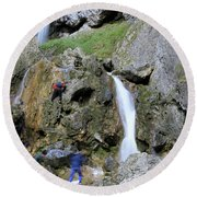 Climbers Making Their Way Up The Cliffs Of Gordale Scar Round Beach Towel