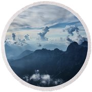 Moody Cloudy Mountains With A Lot Of Contrast And Shadows And Clouds Round Beach Towel
