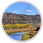 Distant Boat On The San Juan River In Fall Round Beach Towel