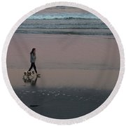 Dog Walking Along The Beach Round Beach Towel