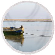 Fishing Boat Resting On The Low Tide Round Beach Towel