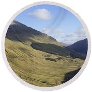 glen in highlands known as  the Rest and be Thankful Round Beach Towel