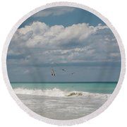 Group Of Pelicans Above The Ocean Round Beach Towel