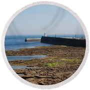 harbour at Seahouses on hazy summer day Round Beach Towel