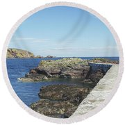 harbour wall and cliffs at St. Abbs, Berwickshire Round Beach Towel