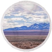 High Plains And Majestic Mountains Round Beach Towel
