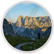 Hiker In The Morning Round Beach Towel