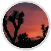 Joshua Trees Silhouetted Against A Red Sky Round Beach Towel