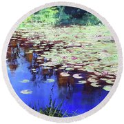 Lilies On Blue Water Round Beach Towel