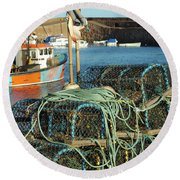 lobster pots and trawlers at Dunbar harbour Round Beach Towel