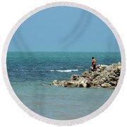 Man On Rocks Looks Out To Ocean From Rocky Beach Jaffna Peninsula Sri Lanka Round Beach Towel