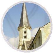 medieval church spire in France Round Beach Towel