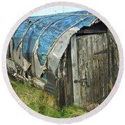 old boat hut at Lindisfarne island Round Beach Towel