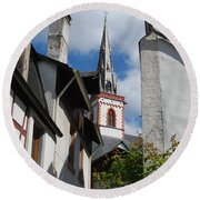 old historic church spire and houses in Ediger Germany Round Beach Towel