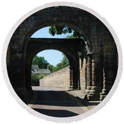 old historic town gate in Hexham Round Beach Towel
