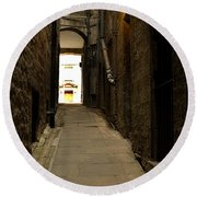 old medieval close in Edinburgh Round Beach Towel