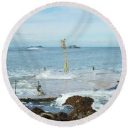 old pier at North berwick and Forth estuary Round Beach Towel