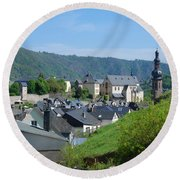 old town walls and church and buildings of Cochem Round Beach Towel