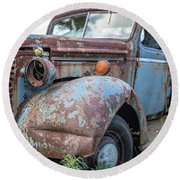 Old Vintage Blue Pickup Truck Among The Weeds Round Beach Towel