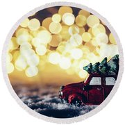 Red Car With Christmas Tree Driving Through Snow Round Beach Towel