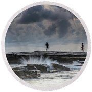 Rock Ledge, Spear Fishermen And Cloudy Seascape Round Beach Towel