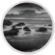 Rocks In The Storm Round Beach Towel