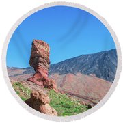 Roque Cinchado In Front Of Mount Teide Round Beach Towel
