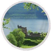 ruins of castle Urquhart on loch Ness Round Beach Towel
