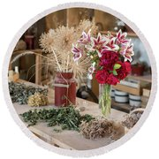 Rustic Wooden Table With Various Herbs And Flowers Round Beach Towel
