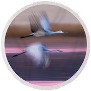 Sandhill Cranes Flying Over Lake Round Beach Towel