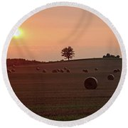 Setting Sun And Hay Bales Round Beach Towel