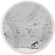 Snow Geese Over Oil Pump 01 Round Beach Towel by Rob Graham