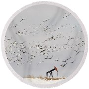 Snow Geese Over Oil Pump 02 Round Beach Towel by Rob Graham
