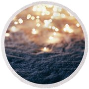Snowy Winter Background With Fairy Lights. Round Beach Towel