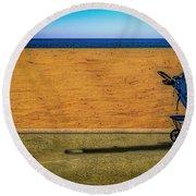 Stroller At The Beach Round Beach Towel by Paul Wear
