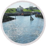 sunlight glistening on water at Eyemouth harbour Round Beach Towel