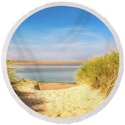 Through The Dunes Over To Budle Bay Round Beach Towel