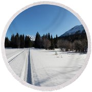Tire Tracks In Snow In An Isolated Area Of The Kenai Peninsula Round Beach Towel