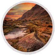 Tryfan Mountain Sunrise Round Beach Towel by Adrian Evans