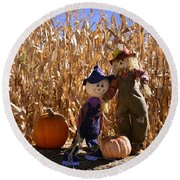 Two Cute Scarecrows With Pumpkins In The Dry Corn Field Round Beach Towel