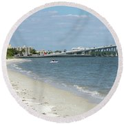 Two Men Set Out On Jet Skis From A Sanibel Island Causeway Islan Round Beach Towel