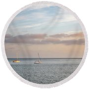 Two Sail Boats In Ocean Sea Facing The Sunset During The Golden  Round Beach Towel