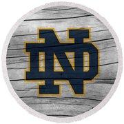 University Of Notre Dame Fighting Irish Logo On Rustic Wood Round Beach Towel