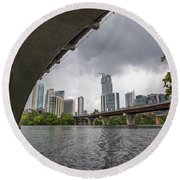 Urban Skyline Of Austin Buildings From Under Bridge With Stormy  Round Beach Towel