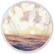 Winter Background With Snow And Fairy Lights. Round Beach Towel