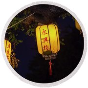 Yellow Chinese Lanterns On Wire Illuminated At Night  Round Beach Towel