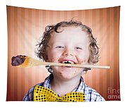 Adorable Little Boy Cooking Chocolate Easter Cake Tapestry